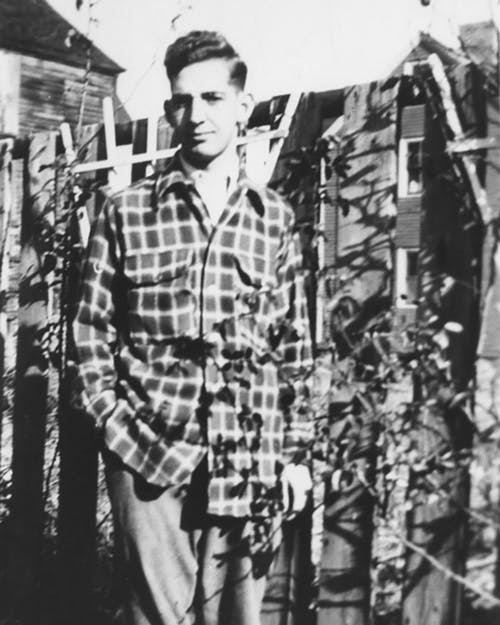 Our founder, Leslie Clough, posed in the backyard of his shop in the late 1960s